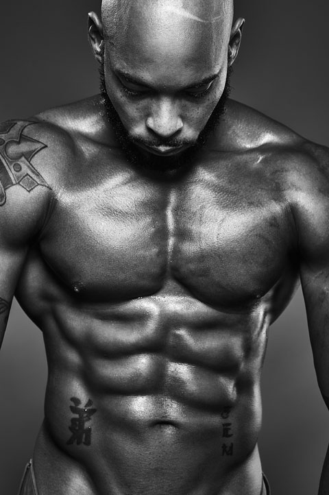Black and white portrait of male bodybuilder with muscular torso