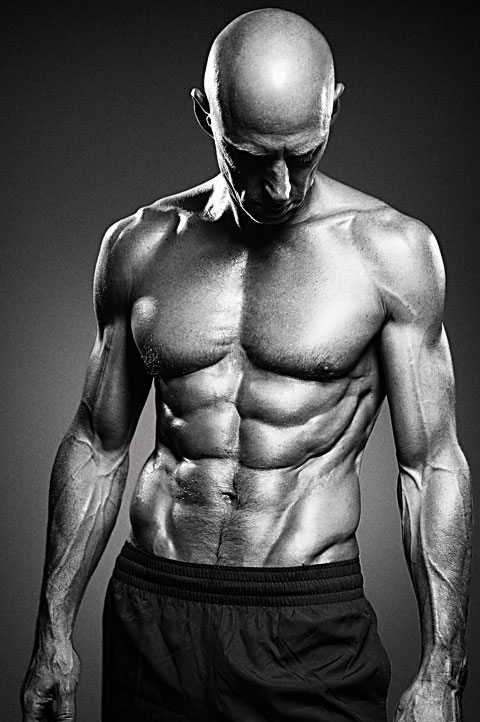 Portrait of bodybuilder in Hollywood. Black and white photo with high contrast lighting