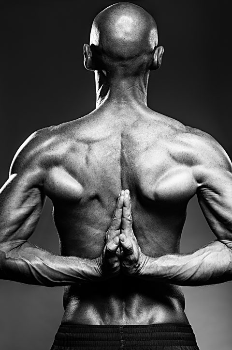 Photo of very muscular Russian gymnast flexing back and arms. Photo by Antonio Carrasco.