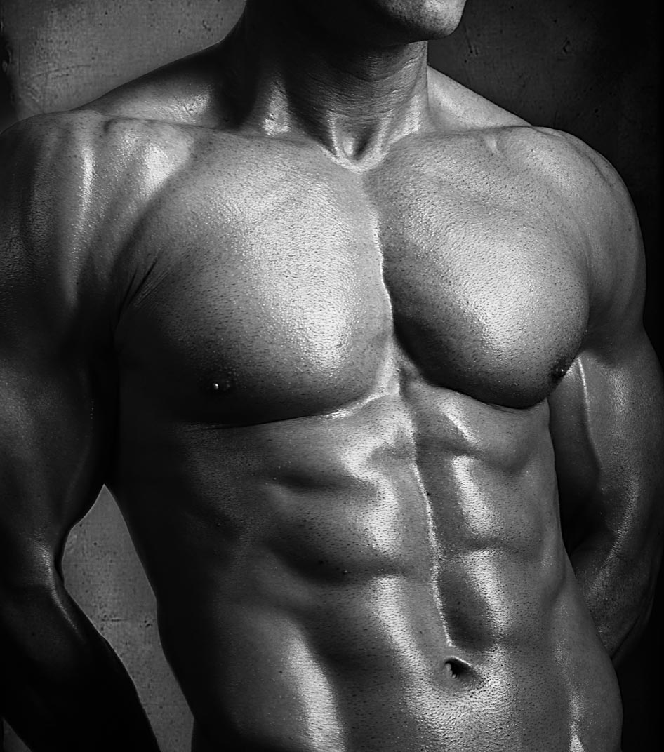 High contrast photo of bodybuilder with muscular torso