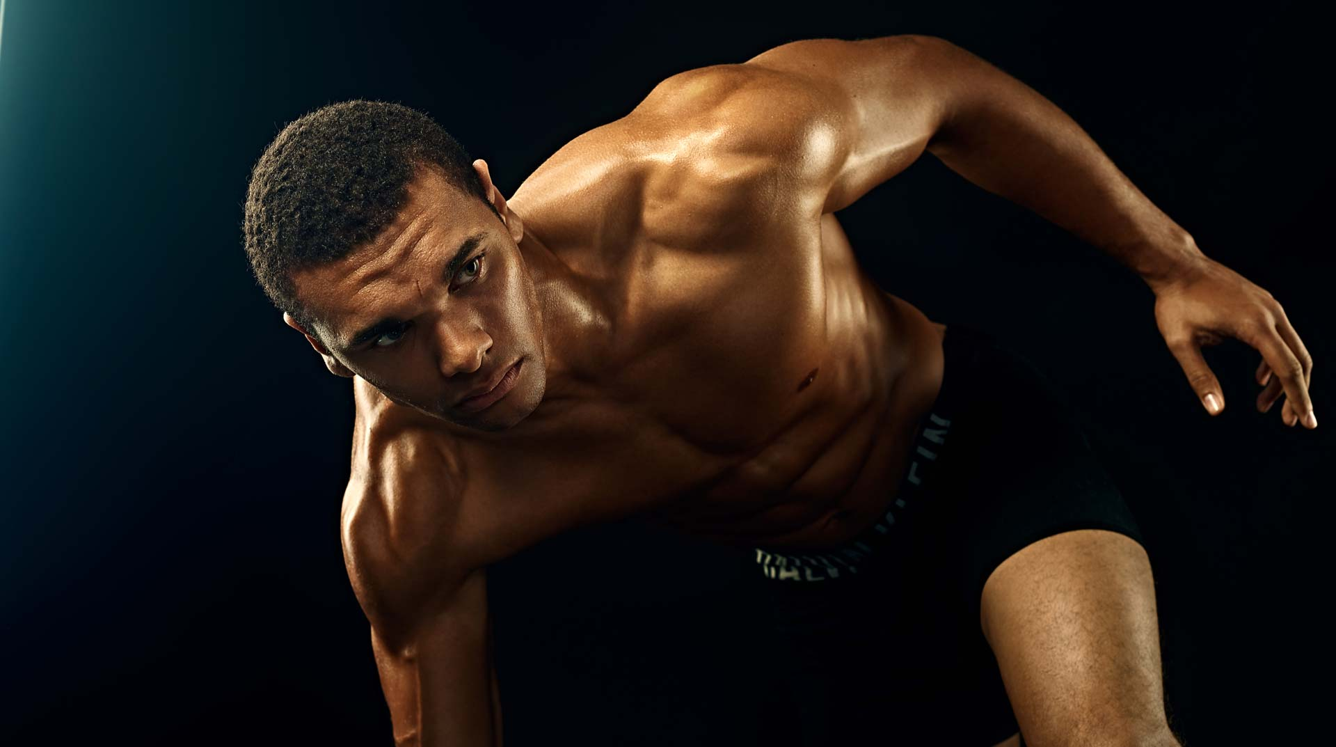 Color photo of athlete preparing to run. Photographed in Studio in Los Angeles